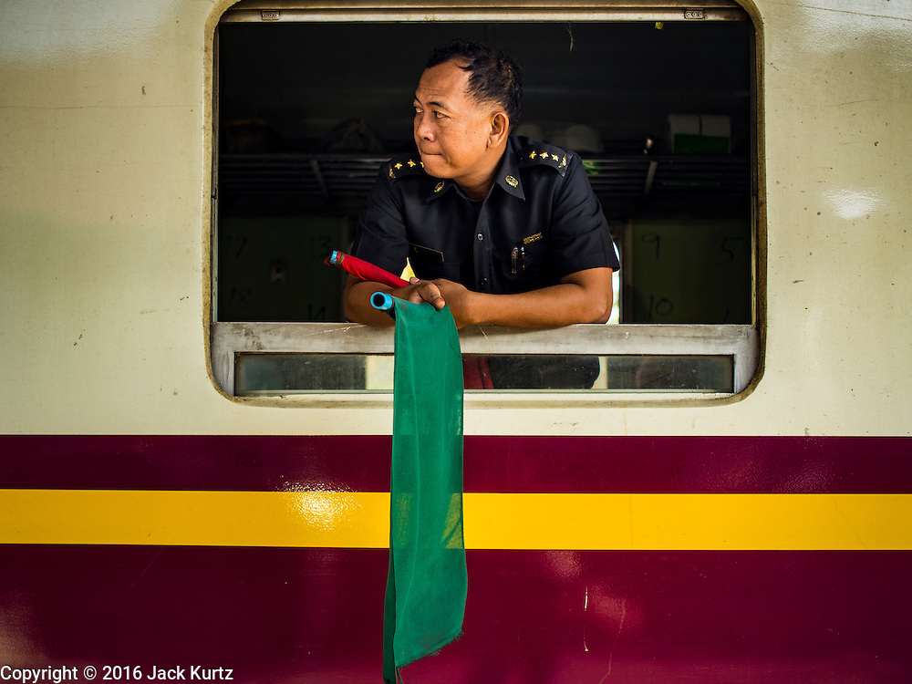 14 JANUARY 2016 - CHACHOENGSAO, CHACHOENGSAO, THAILAND: A train conductor on the Eastern Line train that runs from Bangkok to the Cambodia border.           PHOTO BY JACK KURTZ
