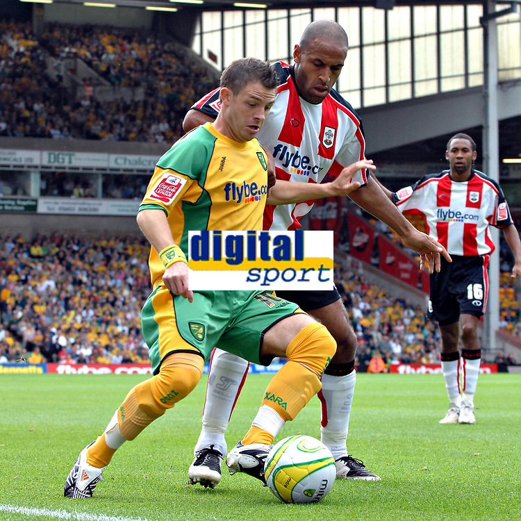 Photo: Ashley Pickering.<br /> Norwich City v Southampton. Coca Cola Championship. 18/08/2007.<br /> Jamie Cureton of Norwich (yellow) holds off Wayne Thomas of Southampton