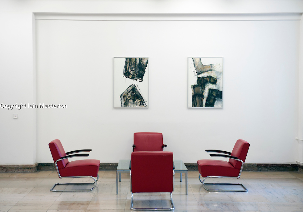 Meeting space with art in corridor at historic Finance Ministry or Bundesministerium der Finanzen in Mitte Berlin Germany