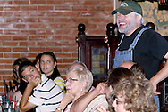 "Jerry Francis (standing) during Mayhem & Mystery's production of ""County Fair Commotion"" at the Spaghetti Warehouse in downtown Dayton, Monday, July 11, 2011."