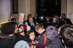 London, UK. 12th February, 2019. Police officers push members and supporters of grassroots trade union United Voices of the World protesting outside the Gadson Club in Pall Mall on the occasion of a reception with Justice Secretary David Gauke against his refusal to negotiate with the trade union over their demands for the London Living Wage, annual leave and sick pay for outsourced cleaners, security guards and receptionists working at the Ministry of Justice, all of whom have been on strike for varying periods recently. The Gadson Club is the official alumni club for the Oxford University Conservative Association.