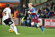 Luke Williams of Scunthorpe United slips ball passed Dean Hammond of Sheffield United  during the Sky Bet League 1 match between Scunthorpe United and Sheffield Utd at Glanford Park, Scunthorpe, England on 19 December 2015. Photo by Ian Lyall.