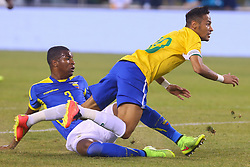 Sep 9, 2014; East Rutherford, NJ, USA; Brazil forward Neymar (10) is tripped up by Ecuador defender Frickson Erazo (3) during the first half at MetLife Stadium.