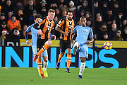 Hull City midfielder Sam Clucas (11) and Fernandinho (25) Manchester City midfielder during the Premier League match between Hull City and Manchester City at the KCOM Stadium, Kingston upon Hull, England on 26 December 2016. Photo by Ian Lyall.