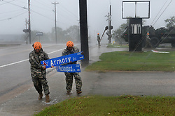 Texas Guardsmen from the 386th Engineer Battalion pick up large debris following Hurricane Harvey in Victoria, Texas, August 26, 2017. More than 1200 Texas Guardsmen partnered with Emergency first responders to support hurricane rescue missions throughout the Gulf Coastal areas of Texas. (U.S. Army National Guard photo by Capt. Martha Nigrelle)