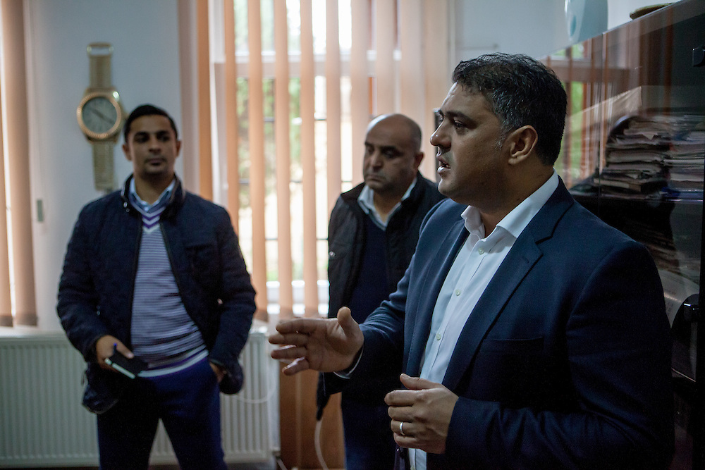 Roma activists Marian Daragiuin (right), Marius Tudor (left) and Negoi Mirel (Local Roma Councilor) at the office of mayor Manole Aurelian at the town hall in Filipestii de Targ to which Marginenii de Jos belongs.