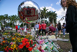 Flowers and balloons are laid at a memorial outside of Marjory Stoneman Douglas High School during the one year anniversary of the shooting deaths of 17 people at the school in Parkland, FL, USA on Thursday, February 14, 2019. Photo by Al Diaz/Miami Herald/TNS/ABACAPRESS.COM