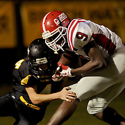 Jacksonville High School's Malik Collins holds on for a touchdown against Topsail's John Covil. (Jason A. Frizzelle)