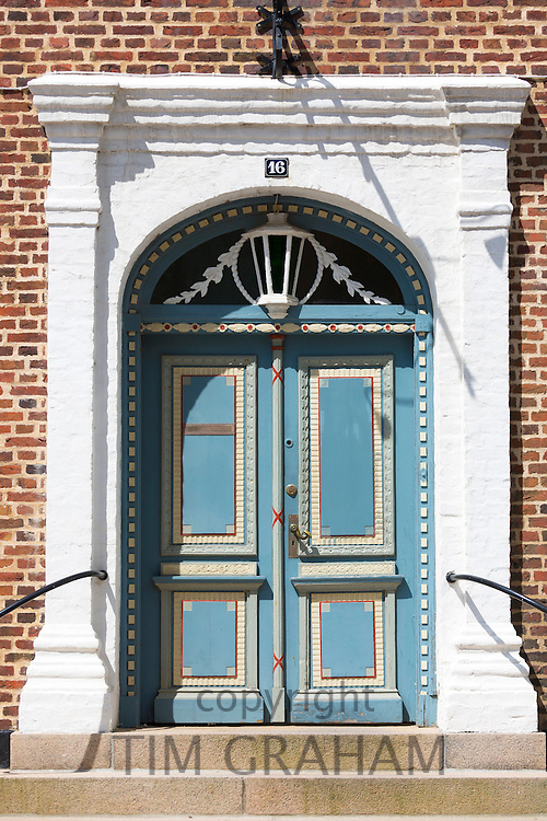Painted ornate door in Gronnegade in medieval Ribe centre, South Jutland, Denmark