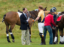 © London News Pictures. 16/06/2013. Tetbury, UK. Prince Harry (centre) resting at half time while taking part in a charity polo event at Beaufont Polo Club in Tetbury, Gloucestershire. Photo credit: Ben Cawthra/LNP