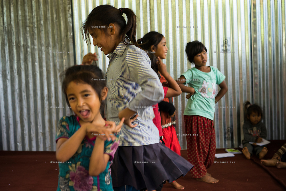 Children dance and play together in the SOS Children's Villages Child Care Space in Rayale, Nepal on 1 July 2015. The Child Care Space was set up by SOS Children's Villages soon after the earthquake so that they children of the village can come together to play, learn, and get over the trauma of the disaster, while their parents can be free to reconstruct their homes and go off to get rations and relief kits. Photo by Suzanne Lee for SOS Children's Villages