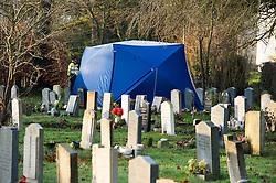 © London News Pictures. 18/12/2013 . Didcot, UK. A police forensics tent in a graveyard at All Saints Church in Dicot where police have started searching in connection with the disappearance of teenager Jayden Parkinson who has been missing since December 3rd. 22 year-old Ben Blakeley has been charged with the murder of 17-year-old Jayden. Photo credit : Ben Cawthra/LNP