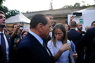 Rome 9 September 2009.Italian Prime Minister Silvio Berlusconi (L) talks with Giorgia Meloni, Italian Minister of Youth, during the opening of the first national meeting of the young people of the PDL (People of Freedom)