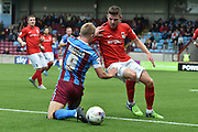 Paddy Madden  and Chris Stokes  fight for the ball during the Sky Bet League 1 match between Scunthorpe United and Coventry City at Glanford Park, Scunthorpe, England on 12 September 2015. Photo by Ian Lyall.