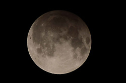 September 17, 2016 - Lahore, Punjab, Pakistan - A view of the full Lunar Eclipse (Chand Grahan) in lahore night. Pakistan will witness penumbral moon eclipse (Chand Grahan)..The lunar eclipse or chand grahan will be notice in different cities of Pakistan including Lahore, Karachi, Multan and other cities.The duration of the Lunar Eclipse in Pakistan will be of 3 hours. The Pakistan Meteorological Department (PMD) said that the lunar eclipse will occur in the country starting from 09:55 pm and will last nearly at 1:54 PM. (Credit Image: © Rana Sajid Hussain/Pacific Press via ZUMA Wire)
