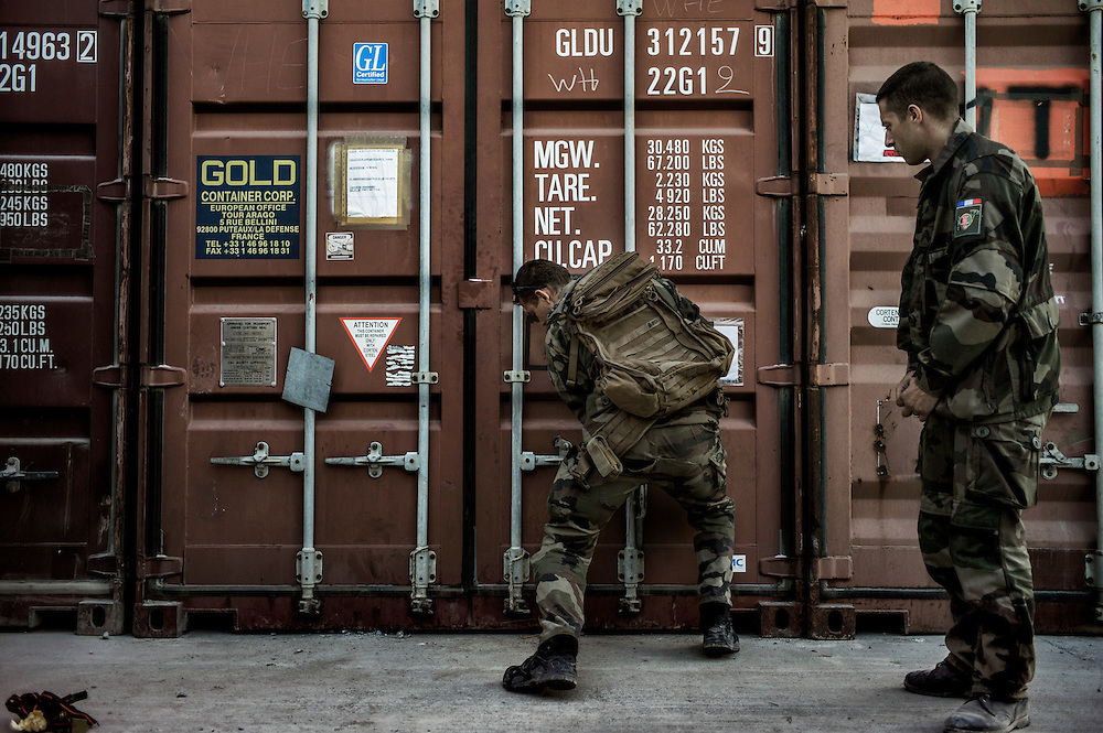 16th BC French unit soldiers close their container where their whole weapons are stored before they go back to France on September 25, 2012  in Warehouse base in Kabul. The French unit from Bitche (Moselle) spent a week disassembling weapons, cleanning tanks and preparing their departure for France. AFP PHOTO / JEFF PACHOUD