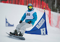 Joe Wadlinger of Brewster Academy approaches the finish line during Wednesday's snowboard race at Gunstock Mountain.  (Karen Bobotas/for the Laconia Daily Sun)