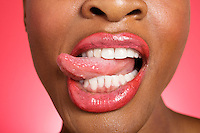 Close up of woman sticking out tongue