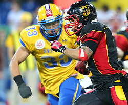 03.06.2014, NV Arena, St. Poelten, AUT, American Football Europameisterschaft 2014, Gruppe A, Schweden (SWE) vs Deutschland (GER), im Bild Marcus Christensson, (Team Sweden, DB, #33) und Danny Washington, (Team Germany, RB, #2) // during the American Football European Championship 2014 group A game between Sweden vs Germany at the NV Arena, St. Poelten, Austria on 2014/06/03. EXPA Pictures © 2014, PhotoCredit: EXPA/ Thomas Haumer