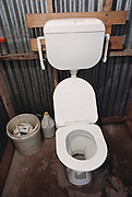 Lagavale family's toilet. Western Samoa. The Lagavale family lives in a 720-square-foot tin-roofed open-air house with a detached cookhouse in Poutasi Village, Western Samoa. Material World Project.