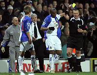 Photo: Paul Thomas.<br /> Blackburn Rovers v Arsenal. The FA Cup. 28/02/2007.<br /> <br /> Referee Graham Poll (R) gives goal scorer Benni McCarthy a yellow card after he celebrates.