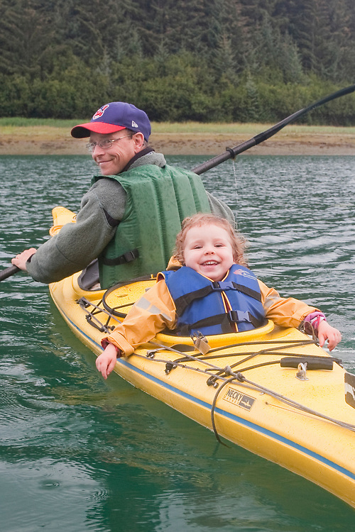 A kayaker and his happy daughter paddle around Glacier Bay National Park. MR MRA