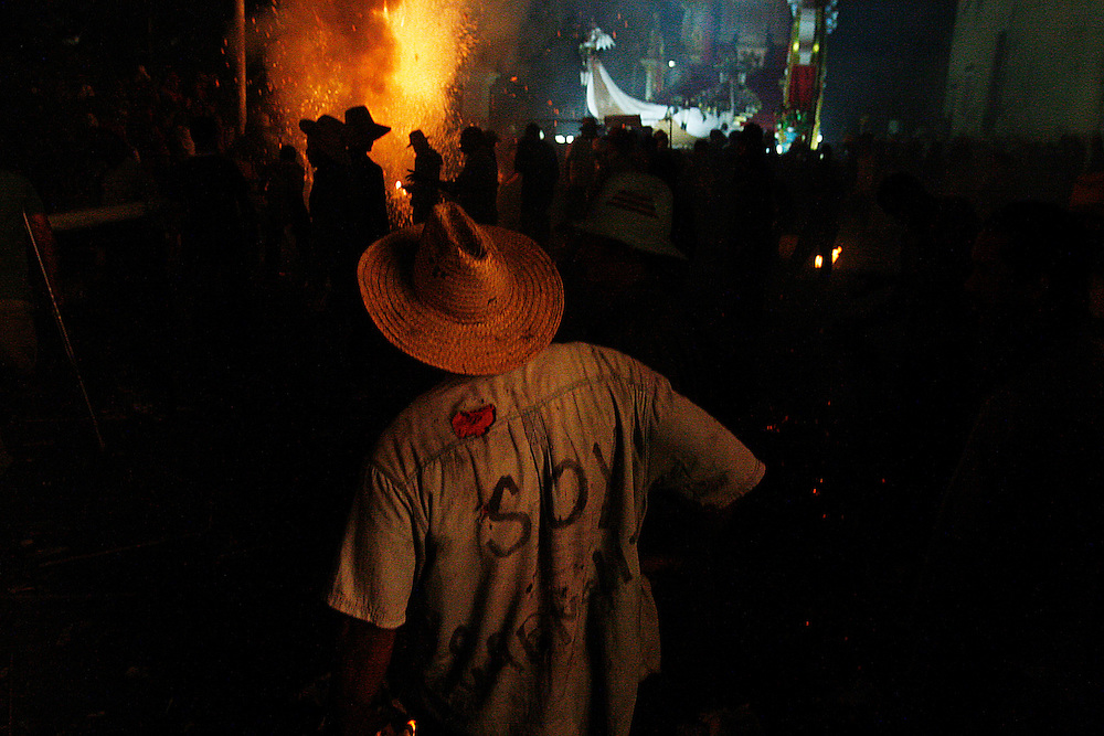 """Las Parrandas"", the insanely chaotic, drunken firework battle is in full swing with neighborhood men in the middle of town square smoking cigars while furiously packing and lighting mortar after mortar to impress the thousands of onlookers. ""Las Parrandas"" continues until daybreak when the Chatholic church on the square opens the door for Christmas service and all leave behind their fireworks and bottles of rum..."