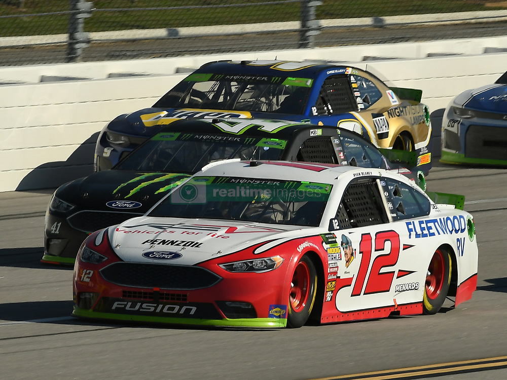 October 14, 2018 - Talladega, AL, U.S. - TALLADEGA, AL - OCTOBER 14: Ryan Blaney, Team Penske, Ford Fusion REV (12), Kurt Busch, Stewart-Haas Racing, Ford Fusion Monster Energy/Haas Automation (41) and Chase Elliott, Hendrick Motorsports, Chevrolet Camaro NAPA NIGHTVISION Lamps (9) race down the backstretch during the 1000Bulbs.com 500 on October 14, 2018, at Talladega Superspeedway in Tallageda, AL.(Photo by Jeffrey Vest/Icon Sportswire) (Credit Image: © Jeffrey Vest/Icon SMI via ZUMA Press)