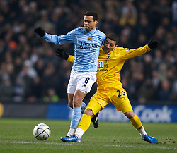 MANCHESTER, ENGLAND - Tuesday, December 18, 2007: Manchester City's Geovanni and Tottenham Hotspur's Aaron Lennon during the League Cup Quarter Final match at the City of Manchester Stadium. (Photo by David Rawcliffe/Propaganda)
