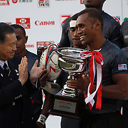 Former Japanese Prime Minister, Yoshiro Mori (current President of the Japan Rugby Football Union) presents the Tokyo 7's Championship Cup to Fiji Captain Osea Koinisau.  Fiji defeated South Africa 33-26 in the Cup Finals on the final day of the Tokyo Sevens, Tokyo, Japan. Photo by Barry Markowitz, (Courtesy STP/TriMarine)