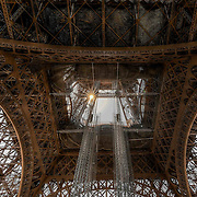 The iron lattice of the Eiffel Tower on the Champ de Mars in Paris, France, makes it the perfect setting for capturing sunbursts