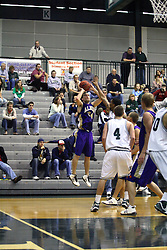 30 December 2006: Dean Raven shoots from the 3 point arc. The Titans outscored the Britons by a score of 94-80. The Britons of Albion College visited the Illinois Wesleyan Titans at the Shirk Center in Bloomington Illinois.<br />