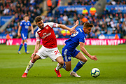 Arsenal defender Shkodran Mustafi (20) tussles with Leicester City midfielder Harvey Barnes (19) during the Premier League match between Leicester City and Arsenal at the King Power Stadium, Leicester, England on 29 April 2019.