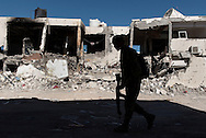 Libya, Sirte: A fighter of the Libyan forces affiliated to the Tripoli government walks in Al Jiza neighbourhood after heavy clashes and bombing happened in the area.  Alessio Romenzi