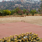Yellow roses sit atop on of the mass graves at the Kigali Memorial Centre in downtown Kigali, Rwanda.