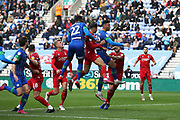 Wigan Athletic defender Cheyenne Dunkley (22) and Wigan Athletic forward Kieffer Moore (19) attack the cross ball during the EFL Sky Bet Championship match between Wigan Athletic and Nottingham Forest at the DW Stadium, Wigan, England on 20 October 2019.