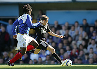 Photo: Lee Earle.<br /> Portsmouth v Blackburn Rovers. The Barclays Premiership. 08/04/2006. Blackburn's Craig Bellamy (R) beats Linvoy Primus to open the scoring.