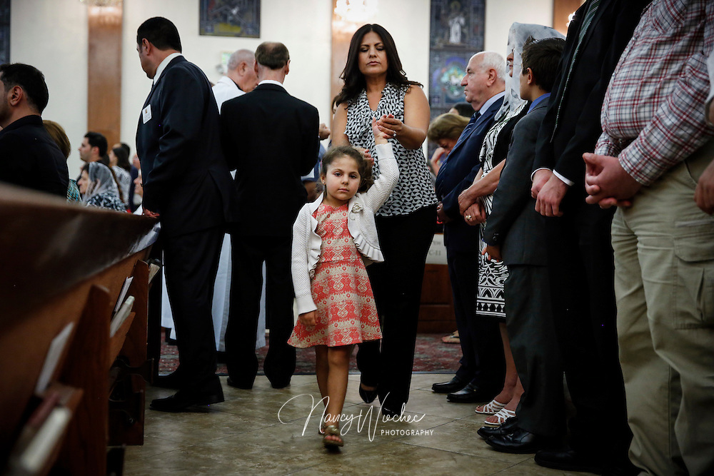 A mother and daughter return to their pew following Communion at St. Peter Chaldean Catholic Cathedral in El Cajon, Calif., Aug. 14, 2015. (Nancy Wiechec for ONE magazine)