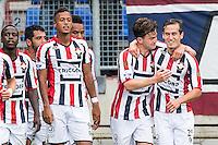 TILBURG - Willem II - Vitesse , Voetbal , Seizoen 2015/2016 , Eredivisie , Koning Willem II Stadion , 09-08-2015 , Willem II speler Erik Falkenburg (2e r) scoort de 1-0 en viert dit met  Willem II speler Stijn Wuytens (r)