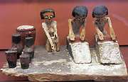 Bakers making bread. Egyptian tombs contained models of aspects of daily life to be taken into the afterlife. Here a model of a bakery.