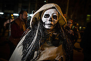 New York, NY - 31 October 2016. A hooded character in a white death mask  in the Greenwich Village Halloween Parade.