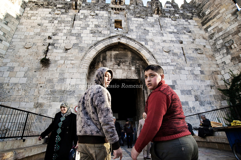 .JERUSALEM : Children walk near Damascus gate in Jerusalem's Old City, on December 08, 2009. Israel and the Palestinians welcomed an EU statement that Jerusalem should be the capital of both the Jewish state and a future Palestinian state..© ALESSIO ROMENZI
