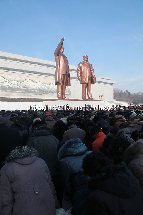60833523<br /> People pay tribute to the bronze statues of late top leaders Kim Il Sung and Kim Jong Il in Pyongyang, capital of the Democratic Peoples Republic of Korea (DPRK), Dec. 16, 2013. People gathered here on Monday to commemorate late leader Kim Jong Il for the second anniversary of his death which falls on Dec. 17. Monday, 16th December 2013. Picture by  imago / i-Images<br /> UK ONLY