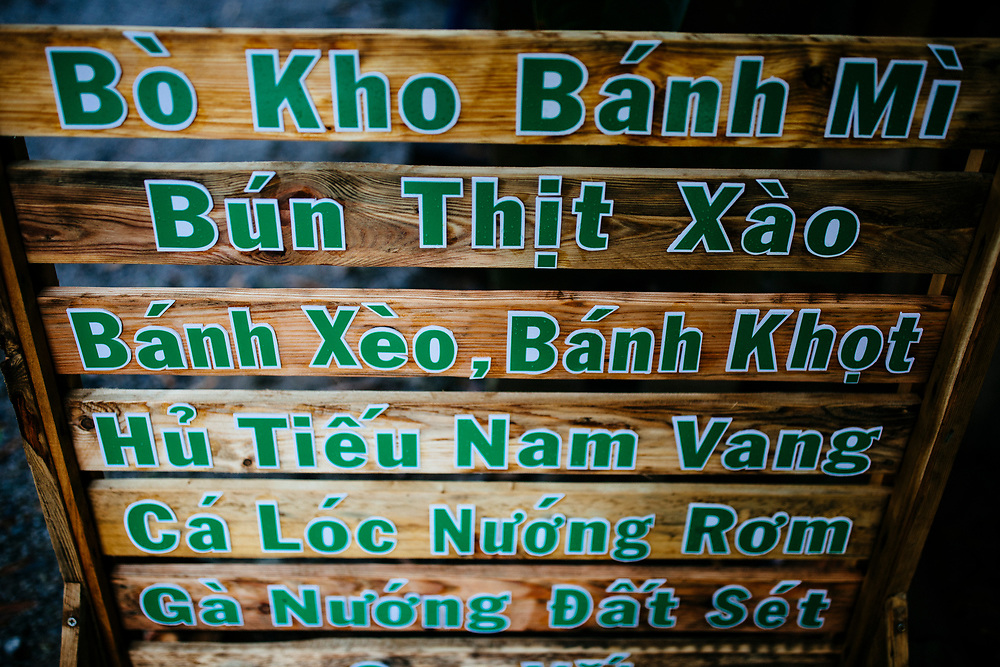 A sign at a restaurant showing lunch options in the Mekong Delta, Vietnam.