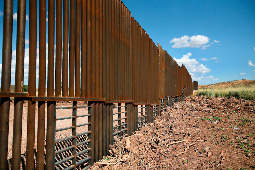 The border fence built on the Mexico/US boundary runs through the desert near Agua Prieta, Mexico and Douglas, Arizona. The newly built fence is part of the project to secure the nearly 2,000 mile border - which is widely considered the most frequently traveled international border in the world, with an estimated 250 legal and 500 million illegal crossings every year.