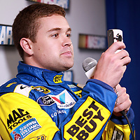 Driver Ricky Stenhouse Jr., the boyfriend of driver Danica Patrick, turns his camera on the media during the NASCAR Media Day event at Daytona International Speedway on Thursday, February 14, 2013 in Daytona Beach, Florida.  (AP Photo/Alex Menendez)
