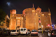 Old city wall illuminated. Perpignan, France.