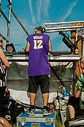 Rave disc jockey, Avonmouth, Bristol, UK, June 2014