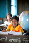 Mosammat Nurun Nahar, 9yrs, student with globe in classroom, Rangia Highscool.