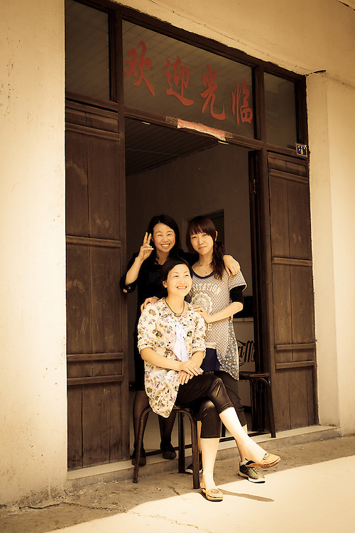 three young women in front of restaurant,Zhoushan,China